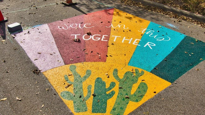 Temporary artwork is shown Nov. 13 at 48th Street and Avenue G, the site of a Healthy Streets program providing greater access to people walking, running and riding bikes.
