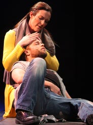 Carrie Gray as Mary Magdalene and Ryan Charles a Jesus