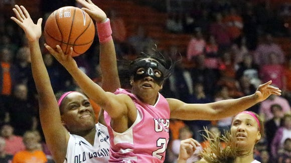 UTEP guard Jenzel Nash drives for a layup against Old Dominion's Destinee Young, left, and Gianna Smith (5) on Thursday night in the Don Haskins Center. Nash missed the shot, but teammate Chrishauna Parker was there to follow up. The Miners prevailed, 70-64.