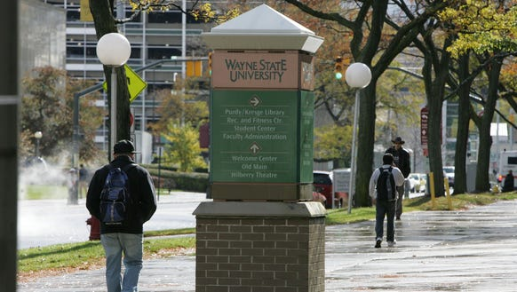 Students walk on the campus of Wayne State University