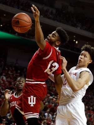 Nebraska Cornhusker forward Isaiah Roby (15) and Indiana Hoosiers forward Juwan Morgan (13) fight for the rebound in the first half at Pinnacle Bank Arena.