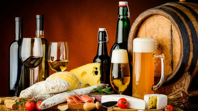 still life with wine, beer, traditional food, cheese and sausages