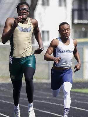 Iowa City West's Wali Parks and Pleasant Valley's Keshaun Baker run in the 200-meter dash during the Hollingsworth Relays at Iowa City West on Saturday, April 9, 2016. (Tork Mason/Freelance)