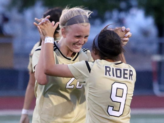 Rider's Ashlyn Heger and Amaya Spearman (9) celebrate after beating Colleyville Heritage 2-0  in the Region I-5A regional quarterfinals in 2018. Heger and Spearman are two of the top returnees in 2019 for the Lady Raiders.