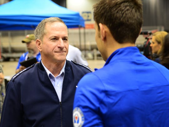 Air Force Chief of Staff Gen. David Goldfein speaks with Master Sgt. Kenneth Guinn, an explosive ordnance disposal troop from Sunray, Texas, at the 2017 Warrior Games July 1, 2017, at McCormick Place-Lakeside Center in Chicago. Goldfein and other members of senior leadership traveled to Chicago for the official opening ceremonies of this year's games to demonstrate their commitment and support for all Team Air Force wounded warriors.