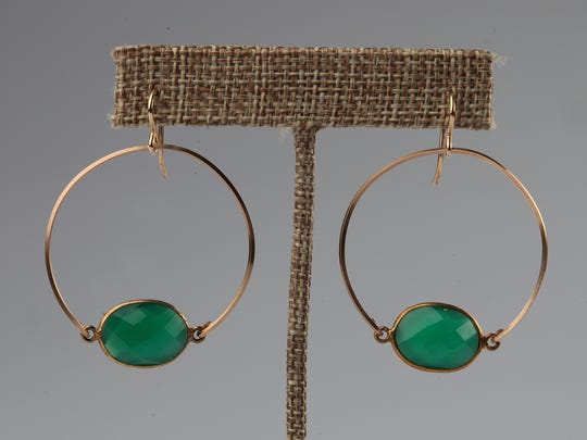 Hoop earrings with green faceted stones will keep you in the green for St. Pat's Day and also the rest of the year. $88 at Merci' Boutique, Chenoweth Square