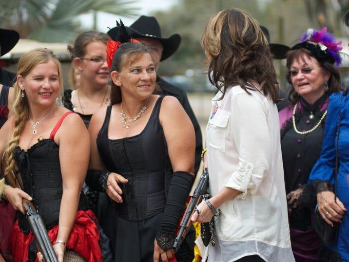 Sarah Palin talks with members of the Arcadia Rodeo