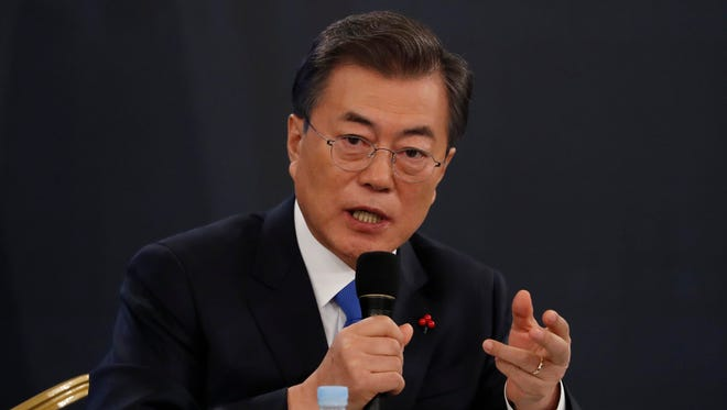 South Korean President Moon Jae-in answers reporters' question during his New Year news conference at the Presidential Blue House in Seoul, South Korea, Wednesday, Jan. 10, 2018. Moon said Wednesday he's open to meeting with North Korean leader Kim Jong Un if certain conditions are met, as he vowed to push for more talks with the North to resolve the nuclear standoff.