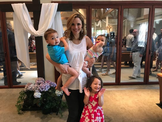 Leah Darrow, with children, is a former model who now encourages women to aspire to godly standards of beauty, not the world's.