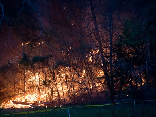 Flames near where a Bell 206 sightseeing helicopter had crashed in Sevier County on Monday, April 4, 2016. (SAUL YOUNG/NEWS SENTINEL)