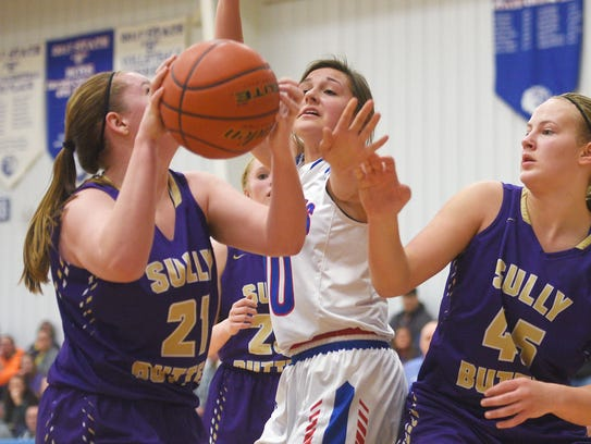 Sully Buttes' Lauren Wittler (21) attempts to shoot