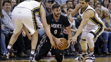 Utah Jazz's Joe Ingles, left, and Raul Neto, right, trap Minnesota Timberwolves guard Ricky Rubio (9) during the second half of an NBA basketball game Friday in Salt Lake City. The Jazz won 98-85.