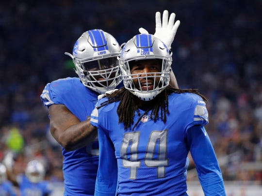 Detroit Lions linebacker Jalen Reeves-Maybin (44) receives a pat on the helmet by teammate defensive tackle A'Shawn Robinson after a play during the second half of an NFL preseason football game against the New England Patriots, Friday, Aug. 25, 2017, in Detroit.