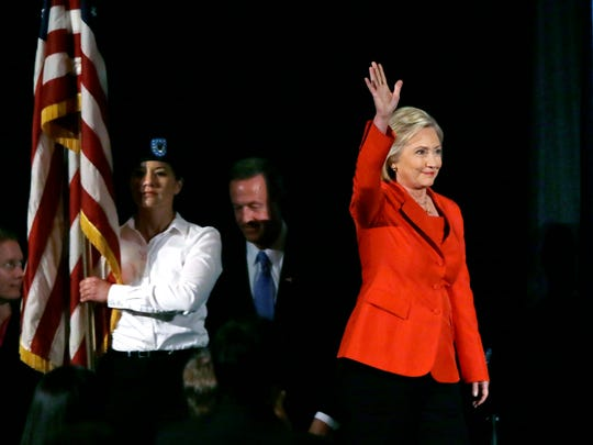 Democratic presidential candidate Hillary Rodham Clinton waves to supporters as she walks on stage during the Iowa Democratic Party's Hall of Fame Dinner, Friday, July 17, 2015, in Cedar Rapids, Iowa.