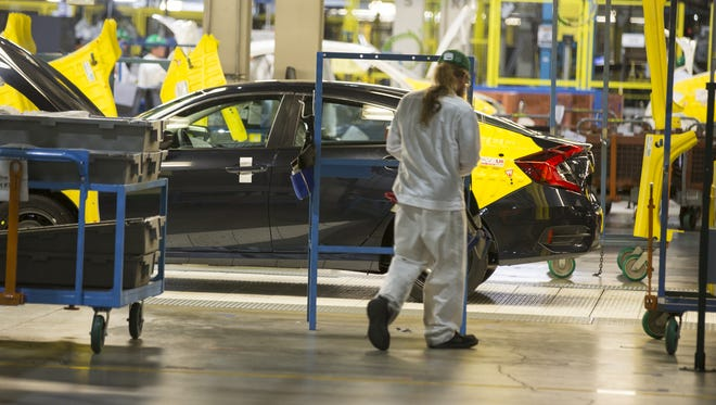 Honda Civics being produced at the Honda Manufacturing of Indiana facility in Greensburg,Ind., on March 22, 2016.