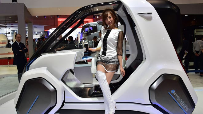 """Japan's auto maker Toyota Auto Body introduces the """"Coms Connect"""" concept electric personal mobility vehicle during a press preview at the Tokyo Motor Show in October"""
