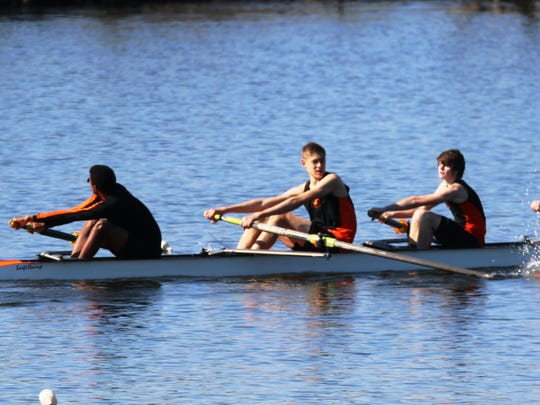 The Northville Rowing Club's (from left) Brett Somerville, Mitchell Encelewski, Aaron Shute and C.J. Daniels, along with coxswain Nicholas Bhandari, captured first in the men's novice fours.