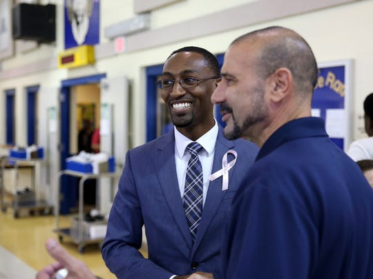 Raa Middle School principal Christopher Small, left, shown with Superintendent Rocky Hanna, was named the 2020 Arts Advocate Award recipient by FSU's Opening Nights.