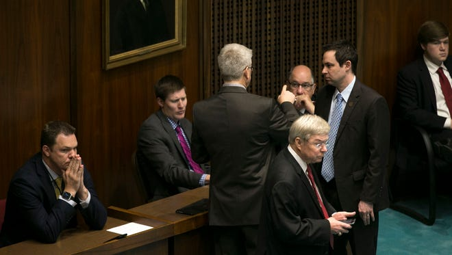 House Speaker J.D. Mesnard (right) speaks with other House members, including Rep. John Allen, R-Scottsdale (background), Rep. Vince Leach, R-Tucson (front) and Rep. Eddie Farnsworth, R-Gilbert (head turned).