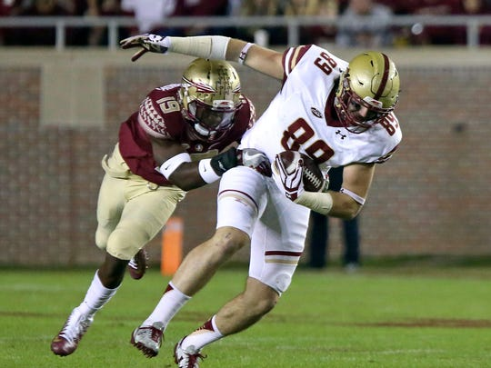 Boston College's Tommy Sweeney is tackled by Florida State's A.J. Westbrook after making a reception in the first half of an NCAA college football game Friday, Nov. 11, 2016, in Tallahassee, Fla. (AP Photo/Steve Cannon)