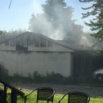 Smoke billows from a roof of a home on the 20 block of Straw Hill Road in Lafayette.