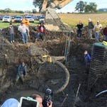 Researchers at the University of Michigan excavated the remains of a woolly mammoth in Chelsea on Thursday.