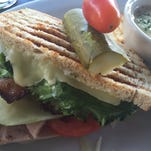 An avocado, bacon, ham and pepperjack cheese panino at Napa-Sonoma South comes with soup, salad or fries.