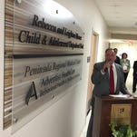 Businessman Leighton Moore delivers a speech, flanked by his wife, Rebecca, on Thursday, April 28, during the dedication of a new outpatient psychiatric unit at Peninsula Regional Medical Center.