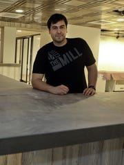 Robert Herrera, co-founder of The Mill in the Nemours Building, at the co-working space in March during renovations. His company manages Theatre N, which is leased from the Buccini/Pollin Group.