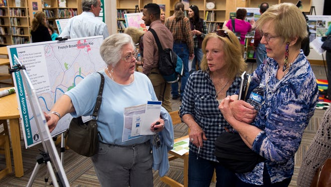 Local residents view the Metropolitan Planning Commission's draft plan for governing development in East Knox County at a public meeting held on Thursday, Feb. 23, 2017, at Carter Elementary School.
