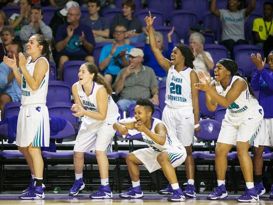 Florida SouthWestern State College basketball players celebrate scoring against Hillsborough Community College on Tuesday at FSW in south Fort Myers. FSW beat Hillsborough 80-64.