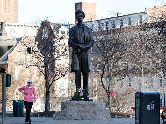 The statue of Abraham Lincoln has been at Lytle Park for 100 years. Although controversial then, it is now plays host to tributes on the 16th president's birthday.