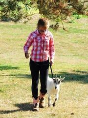 Acelyn Quaintance walks her pygmy goat, Ruby, around