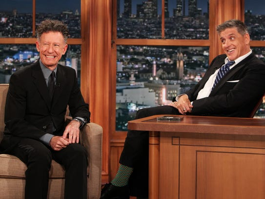 "This Wednesday, April 23, 2014 photo released by CBS shows Lyle Lovett, left, and Craig Ferguson on ""The Late Late Show with Craig Ferguson,"" on the CBS Television Network. Ferguson says he is stepping down as host of the show this year. CBS said that Ferguson made the announcement to his studio audience Monday, April 28, 2014.  (AP Photo/CBS, Sonja Flemming) MANDATORY CREDIT, NO ARCHIVE, NO SALES, FOR NORTH AMERICAN USE ONLY"