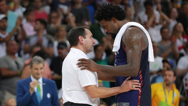 USA center DeAndre Jordan (6) greets Mike Krzyzewski during the men's basketball semifinal match against Spain in the Rio 2016 Summer Olympic Games at Carioca Arena 1.