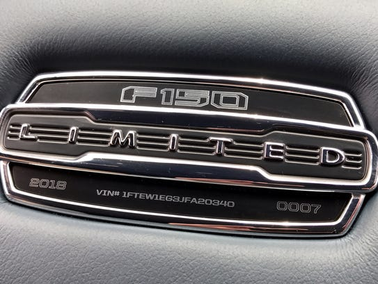 A plaque on the center armrest on the 2018 Ford F-150