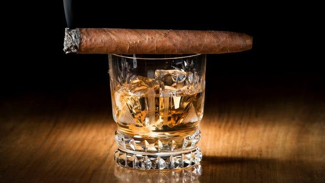 Whiskey and cigar.
