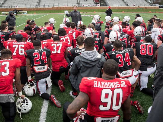 Ball State head coach Mike Neu talks to the team after