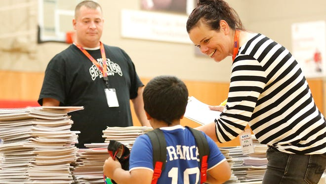 Tim Schwartz and Gillian King help a student select school supplies on Saturday, Aug. 20, at the Fond du Lac Family YMCA. The annual Back to School program provides low-income students with necessary school supplies.