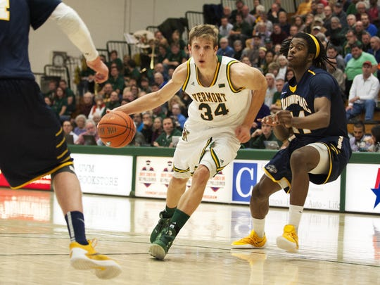 Catamounts guard Kurt Steidl (34) drives to the hoop during the men's basketball game between the Quinnipiac Bobcats and the Vermont Catamounts at Patrick Gym on Wednesday night.