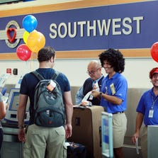 FORT LAUDERDALE, FL - SEPTEMBER 27:  Customers check-in at the Southwest counter at the Fort Lauderdale-Hollywood International Airport on September 27, 2010 in Fort Lauderdale, Florida.In a trend of continuing airline consolidation Southwest Airlines, Co. will buy its rival AirTran Airways for an estimated $1.4 billion.  (Photo by Joe Raedle/Getty Images)