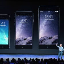 CUPERTINO, CA - SEPTEMBER 09:  Apple Senior Vice President of Worldwide Marketing Phil Schiller announces the new iPhone 6 during an Apple special event at the Flint Center for the Performing Arts on September 9, 2014 in Cupertino, California.