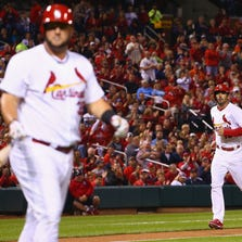 ST. LOUIS, MO - SEPTEMBER 16: Matt Adams #32 of the St. Louis Cardinals draws a bases-loaded walk to score Matt Carpenter #13 of the St. Louis Cardinals in the first inning against the Milwaukee Brewers at Busch Stadium on September 16, 2014 in St. Louis, Missouri.  (Photo by Dilip Vishwanat/Getty Images)