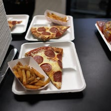Pizza slices and french fries.