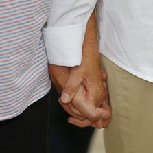 SALT LAKE CITY, UT - JUNE 25:  Laurie Wood, (L) and her partner Kody Partridge hold hands at a press conference after the 10th Circuit Court in Denver rejected a same-sex marriage ban in Utah on June 25, 2014 in Salt Lake City, Utah. The federal appeals court found Utah's laws to be unconstitutional