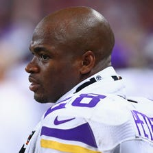 ST. LOUIS, MO - SEPTEMBER 7: Adrian Peterson #28 of the Minnesota Vikings looks on from the sideline during a game against the St. Louis Rams at the Edward Jones Dome on September 7, 2014 in St. Louis, Missouri.  The Vikings beat the Rams 34-6.