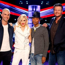 """From left, Adam Levine, Gwen Stefani, Pharrell Williams, Blake Shelton on the set of """"The Voice,""""on May 5, 2014. The show premiers on Sept. 22."""