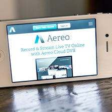 In this photo illustration, Aereo.com, a Web service that provides television shows online, is shown on an iPhone 4S on April 22, 2014, in New York City.