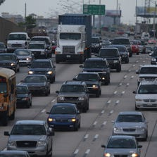 Cars and trucks drive down Interstate 95 July 11, 2007 in Miami, Florida.