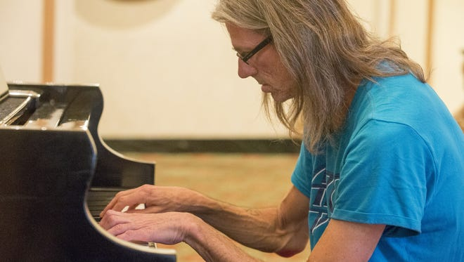 John Christopher Jones plays piano at the Omni Severin Hotel in Indianapolis.